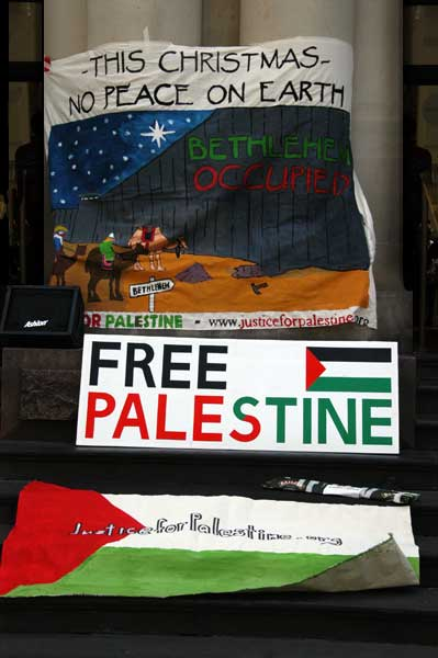 Banners illustrate journey of the three wise halted by the apartheid wall